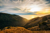 Sunset over the Pacific Ocean seen from the Nacimiento-Fergusson road  through the Santa Lucia Range  in California