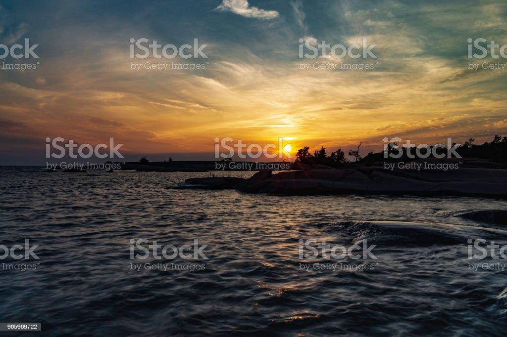 Sonnenuntergang über der Philip-Edward-Insel - Lizenzfrei Abenddämmerung Stock-Foto