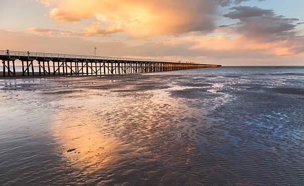 Urangan molo al tramonto Hervey Bay, Australia - foto stock