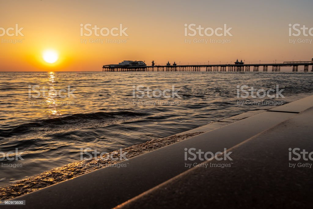 Sunset over the pier in Blackpool, Lancashire stock photo