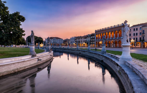 sunset over the prato della valle square in padova, italy - della stock pictures, royalty-free photos & images