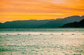 Sunset over the Red Sea in Eilat, Israel. Beautiful evening sea landscape. View of the sea and mountains