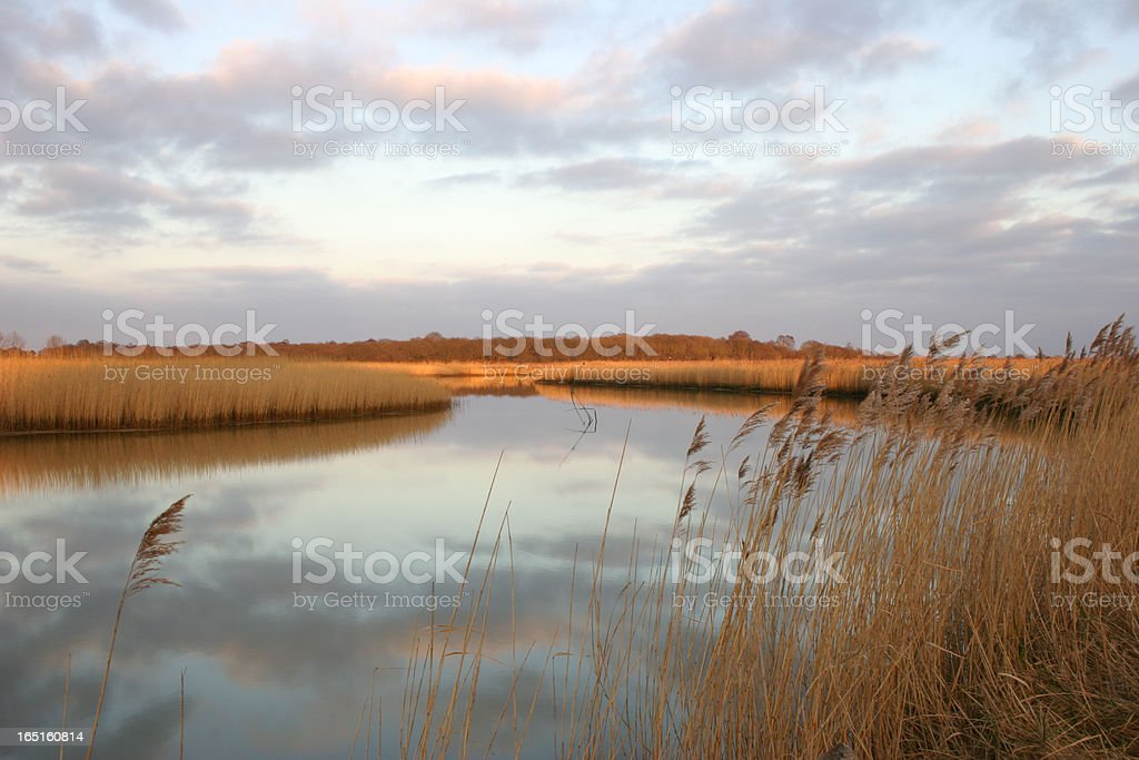 Sunset over the River Alde and Snape Marshes, Suffolk stock photo