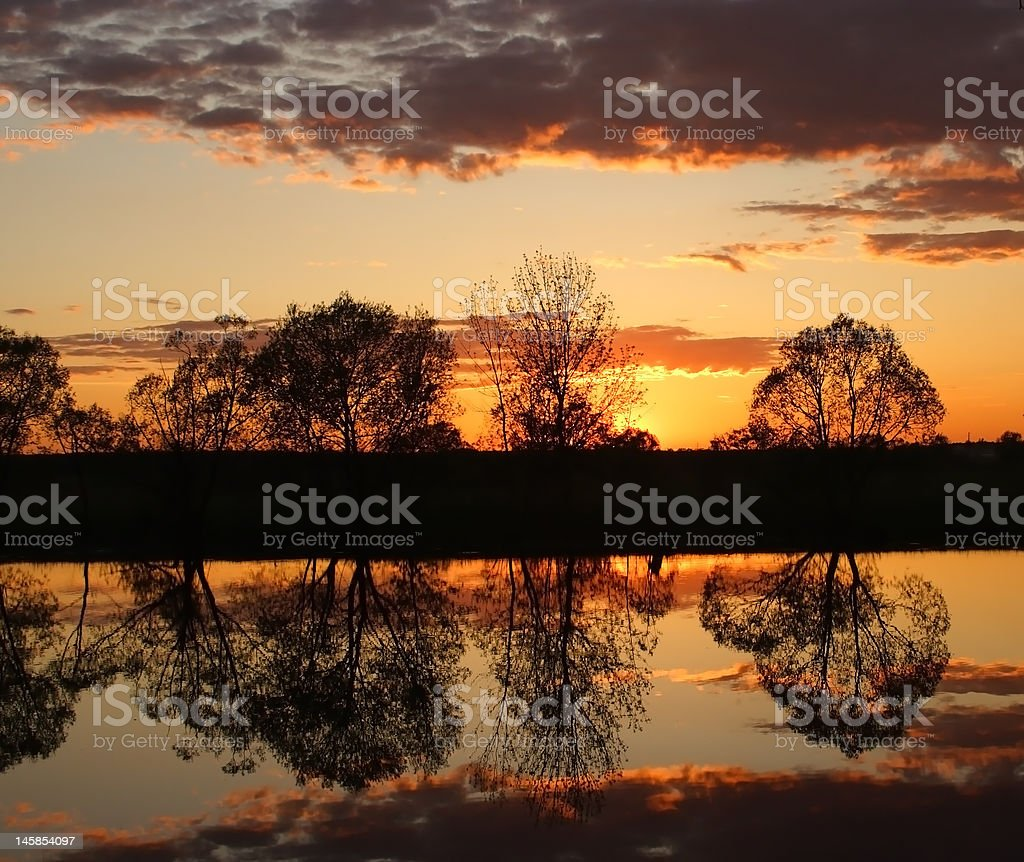 Sunset over the river royalty-free stock photo