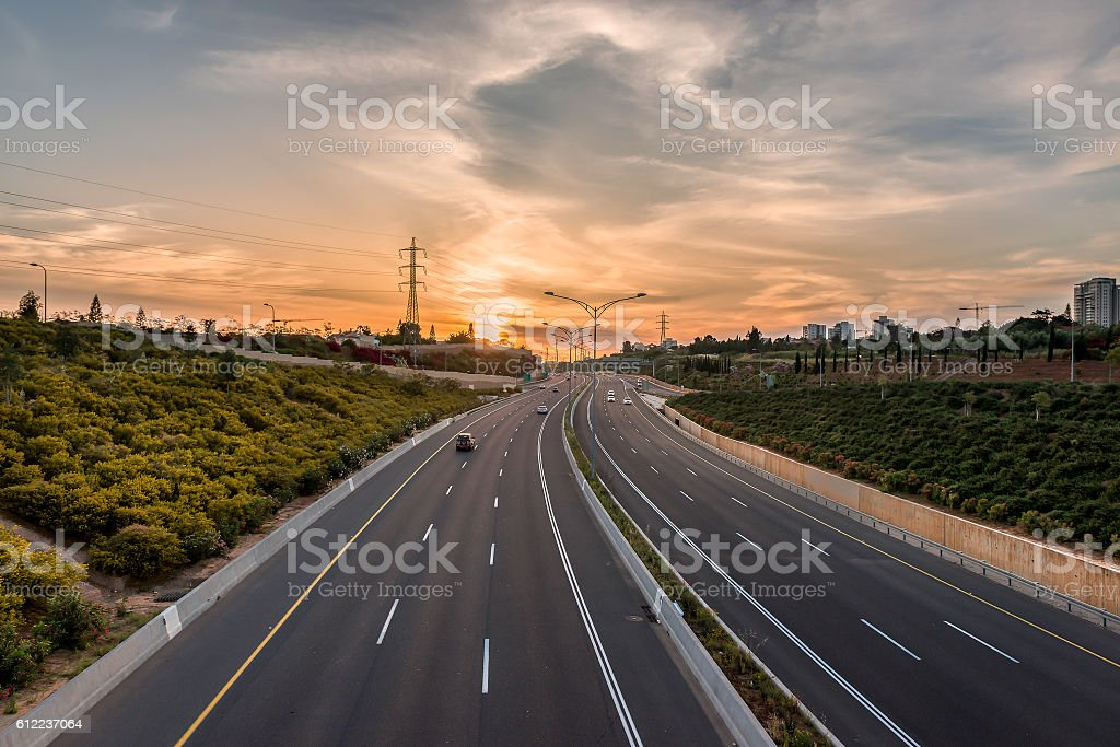 Sunset over the road stock photo