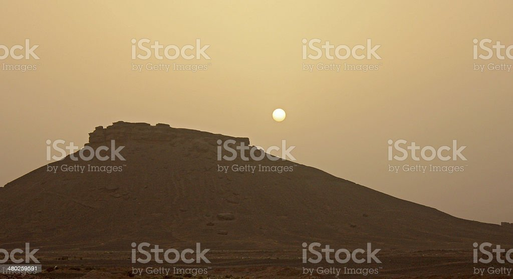 Sunset over the rock royalty-free stock photo