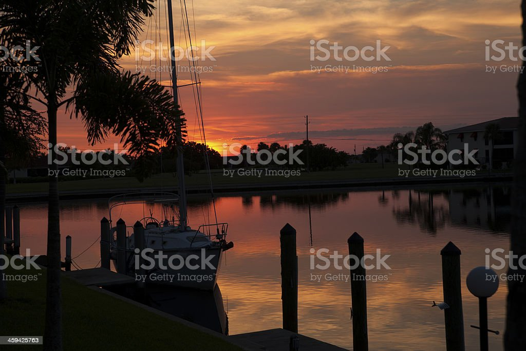 sunset over the sail boat stock photo