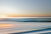 Abstract seascape. Sunset over the sea. Long exposure, copy space
