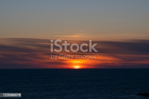 1130689824 istock photo Sunset over the sea in Cornwall 1225590078