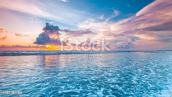 Amazing colorful sunset over sea form Bali beach and majestic cloudscape