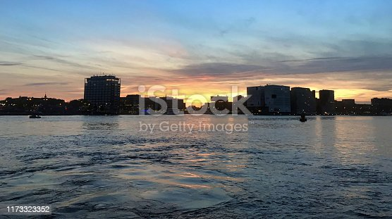 sunset over the skyline of the old city of amsterdam with ADAM tower at the river IJ in the netherlands