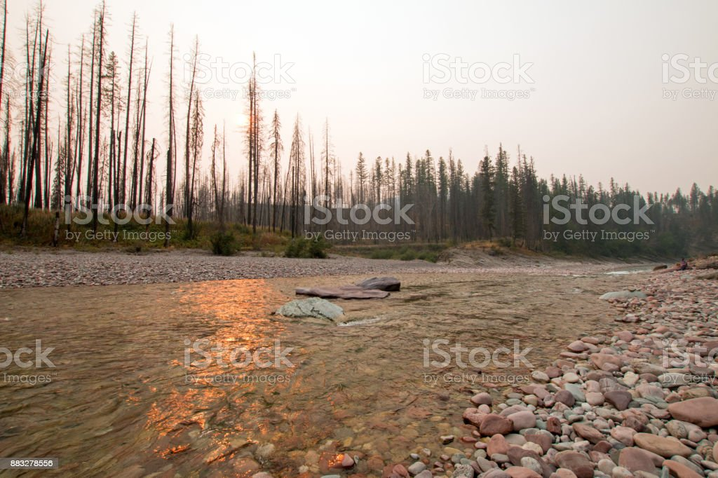 Sunset over the South Fork of the Flathead River at Meadow Creek Gorge in the Bob Marshall Wilderness complex during the 2017 fall fires in Montana United States stock photo