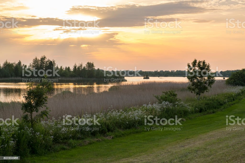 Sunset over the Vossenmeer lake during summer stock photo