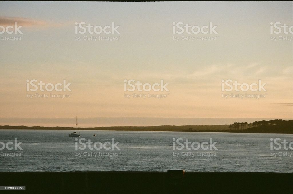 Sunset over the water in Wales stock photo