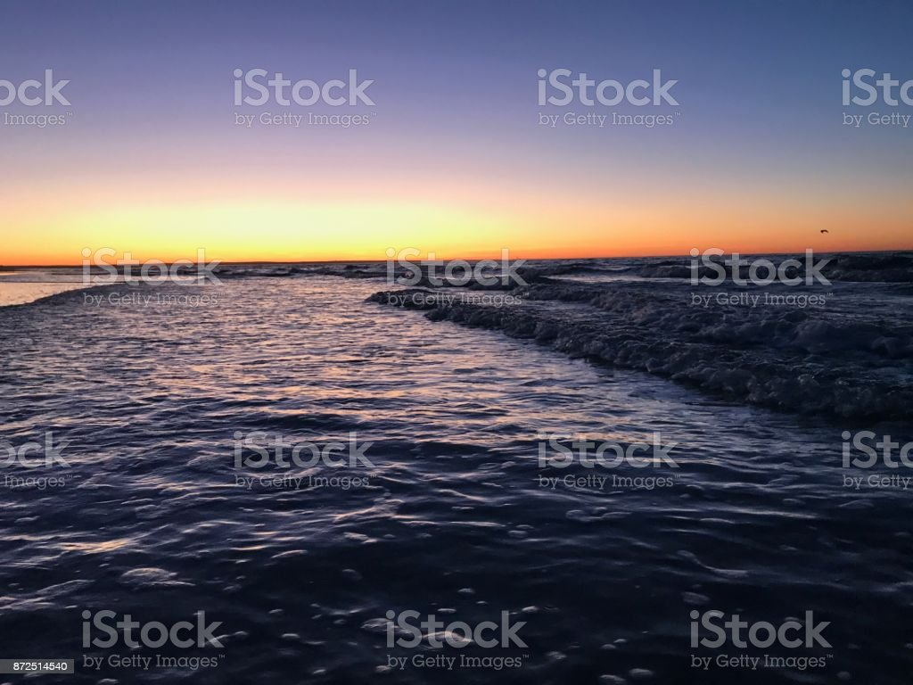 Sunset over the water stock photo