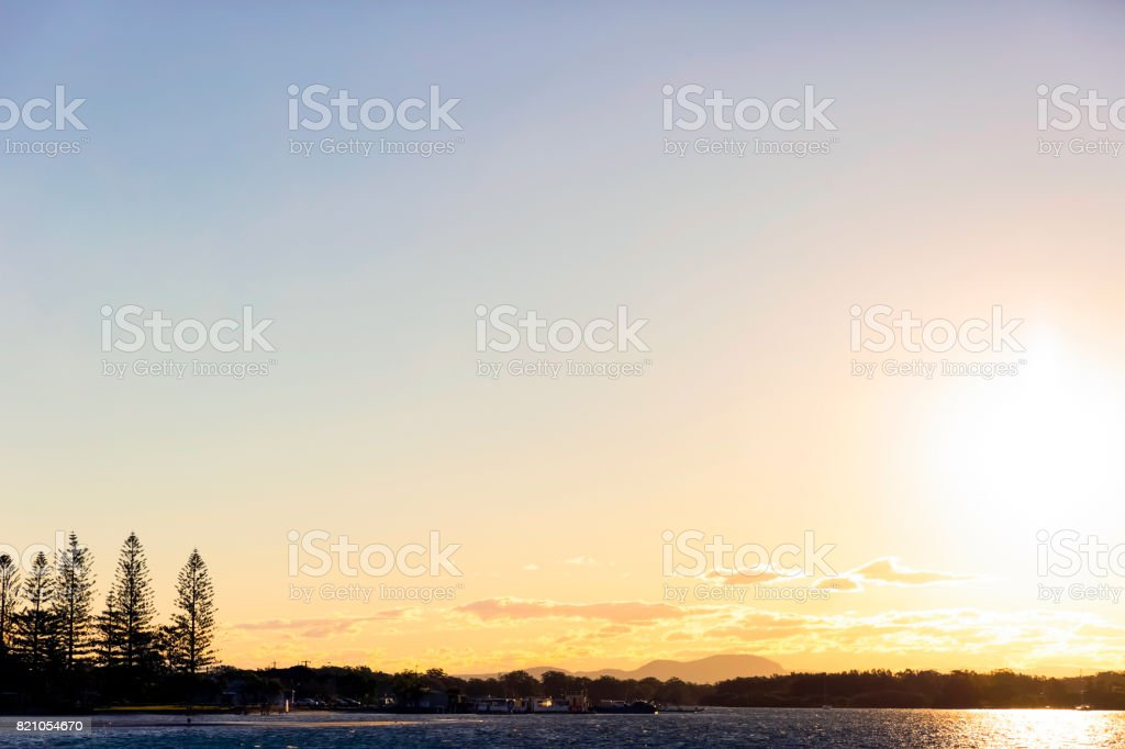Sunset over the water, Port Macquarie, sky background, copy space stock photo