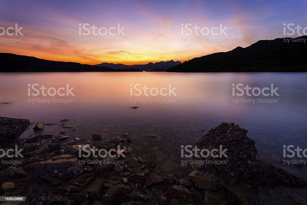 Sunset over the water reserves of Hong Kong royalty-free stock photo