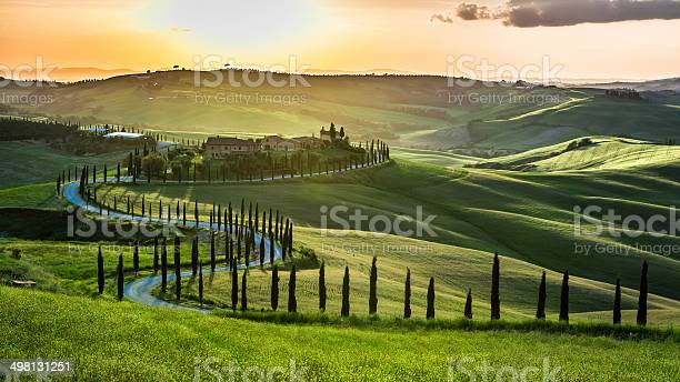 Sunset over the winding road with cypresses in tuscany picture id498131251?b=1&k=6&m=498131251&s=612x612&h=rwbsepfvqnm01pqwswg xexfsss1cv4lmntgtqtacrq=
