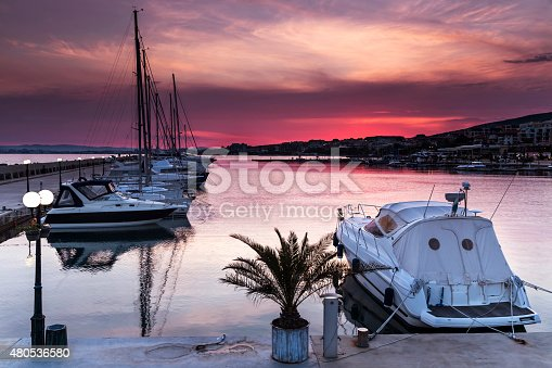 Luxury yacht on the marina at sunset