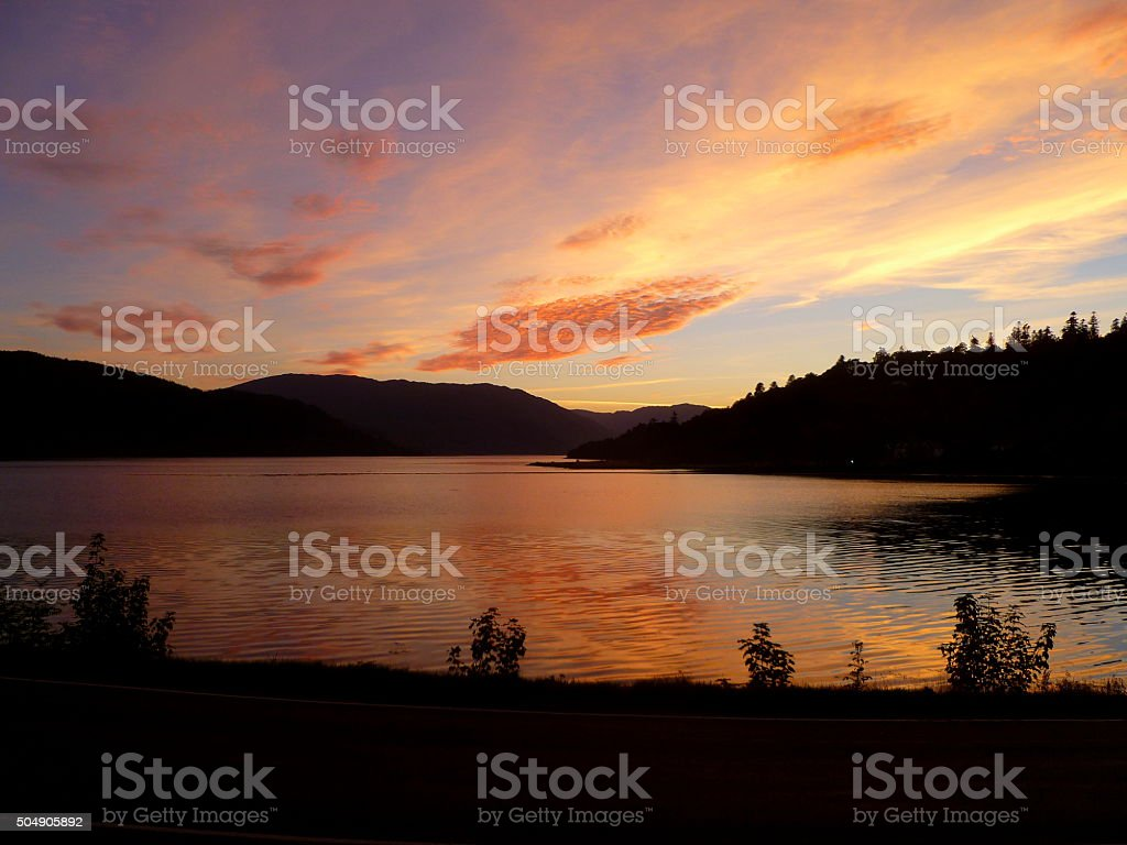 Sunset Over Tranquil Loch stock photo