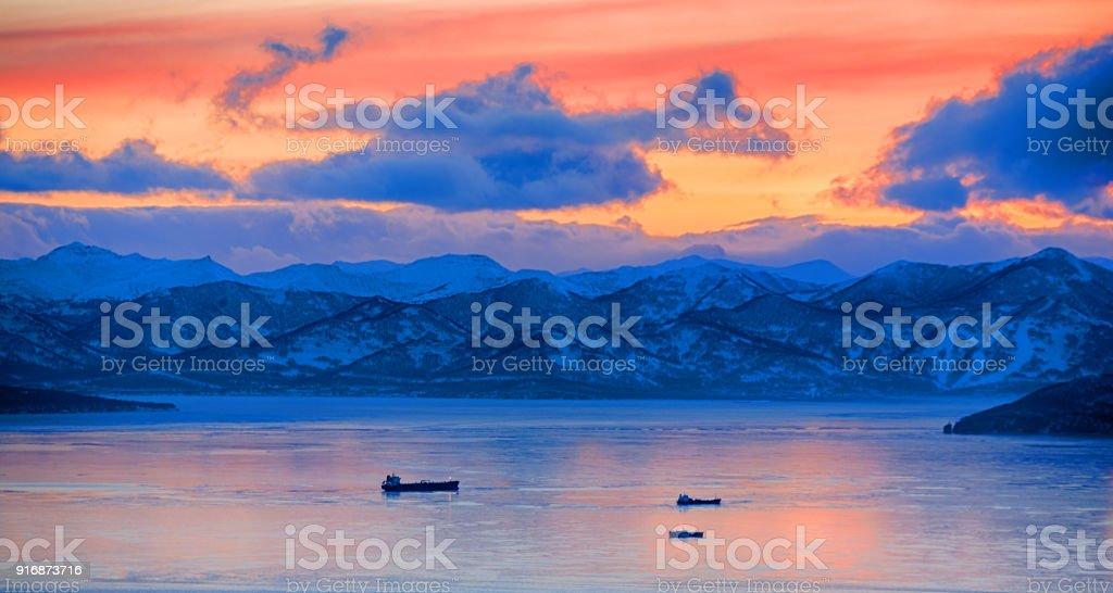 Sunset over vespers Petropavlovsk-Kamchatsky on the background of the Avachinsky bay stock photo