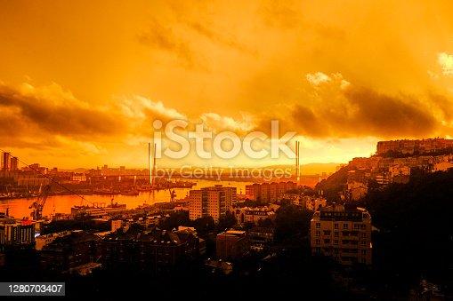 Sunset over Vladivostok, Russia. Far East. View of Zolotoy bridge (Golden Horn bridge) and the Golden Horn Bay.