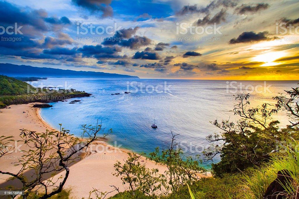 Sunset over Waimea Bay on Oahu's North Shore stock photo