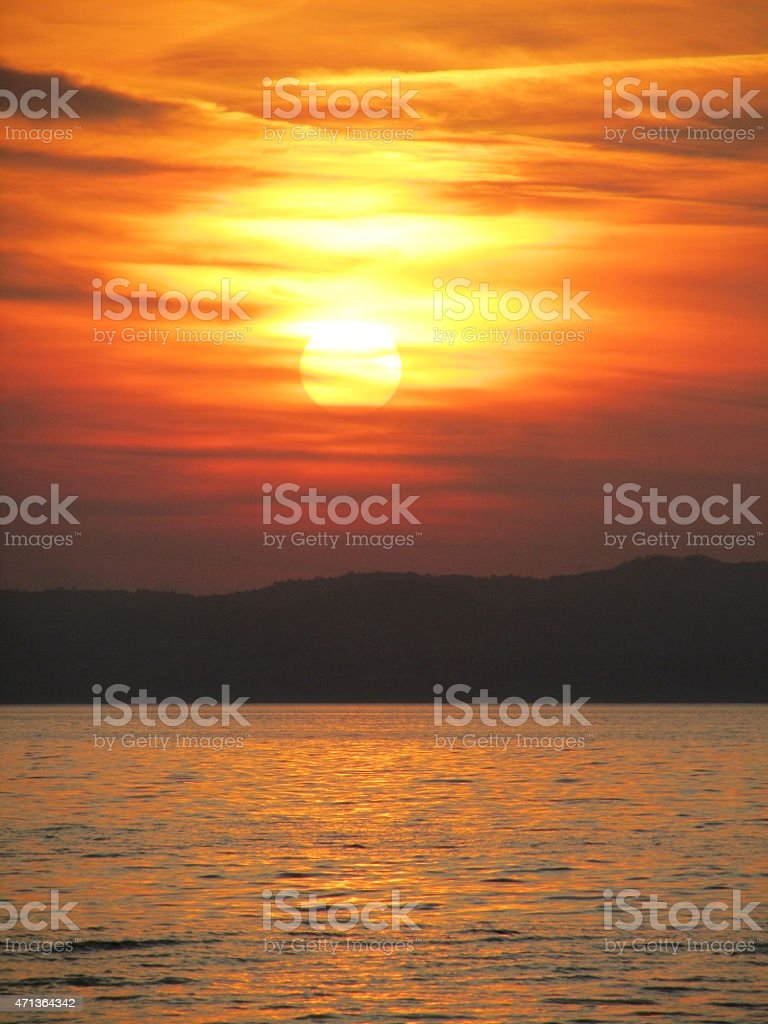 Sunset over water, Lake Garda, Italy, The Sky is burning stock photo
