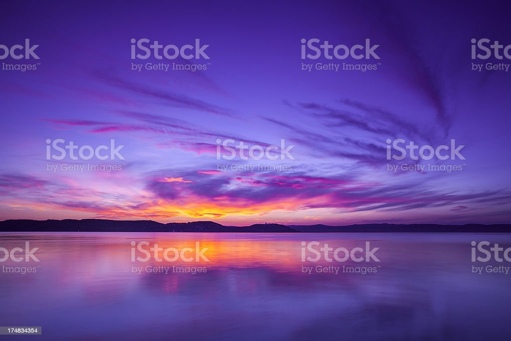 Sunset over water stock photo