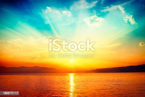 istock sunset over water 186875112
