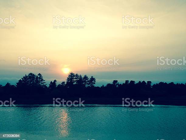 Sunset Over Water Stock Photo - Download Image Now
