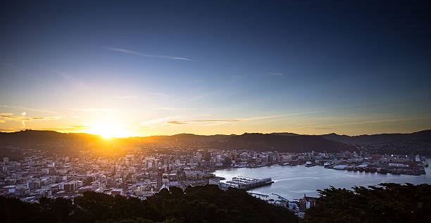 Sunset Over Wellington Cityscape Still from Getty time lapse video #625850288. View of Wellington from Mount Victoria at sunset, just as the sun hits the horizon. mt victoria canadian rockies stock pictures, royalty-free photos & images