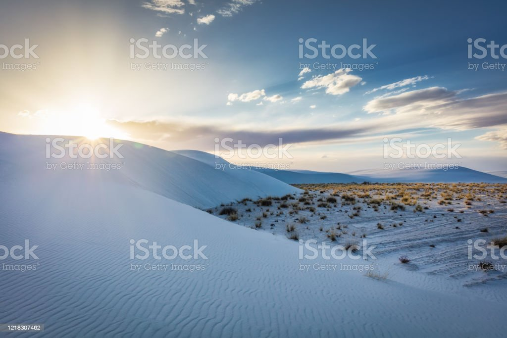Sunset Over White Sands Desert Dunes New Mexico USA - Royalty-free Atmospheric Mood Stock Photo