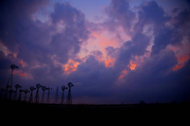 Sunset over Windmills stock photo