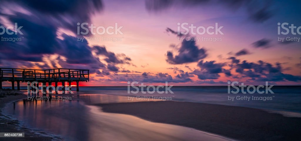 Sunset over wooden pier panorama stock photo