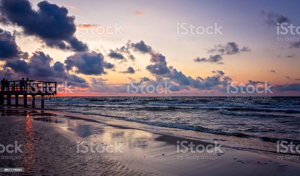 Sunset over wooden pier stock photo