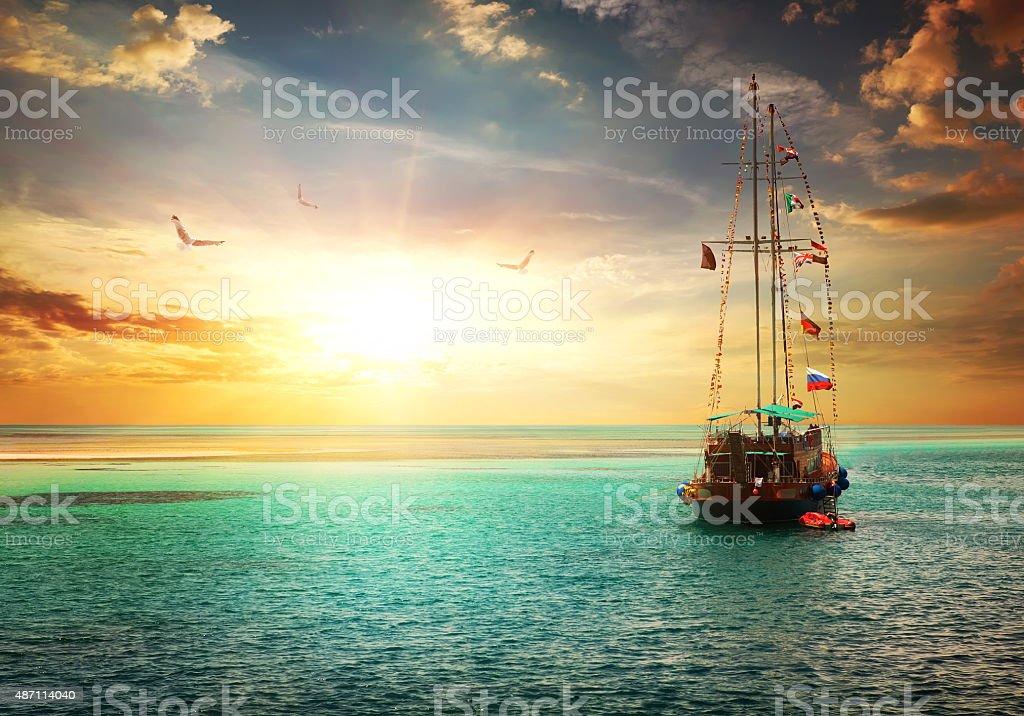 Sunset over yacht stock photo