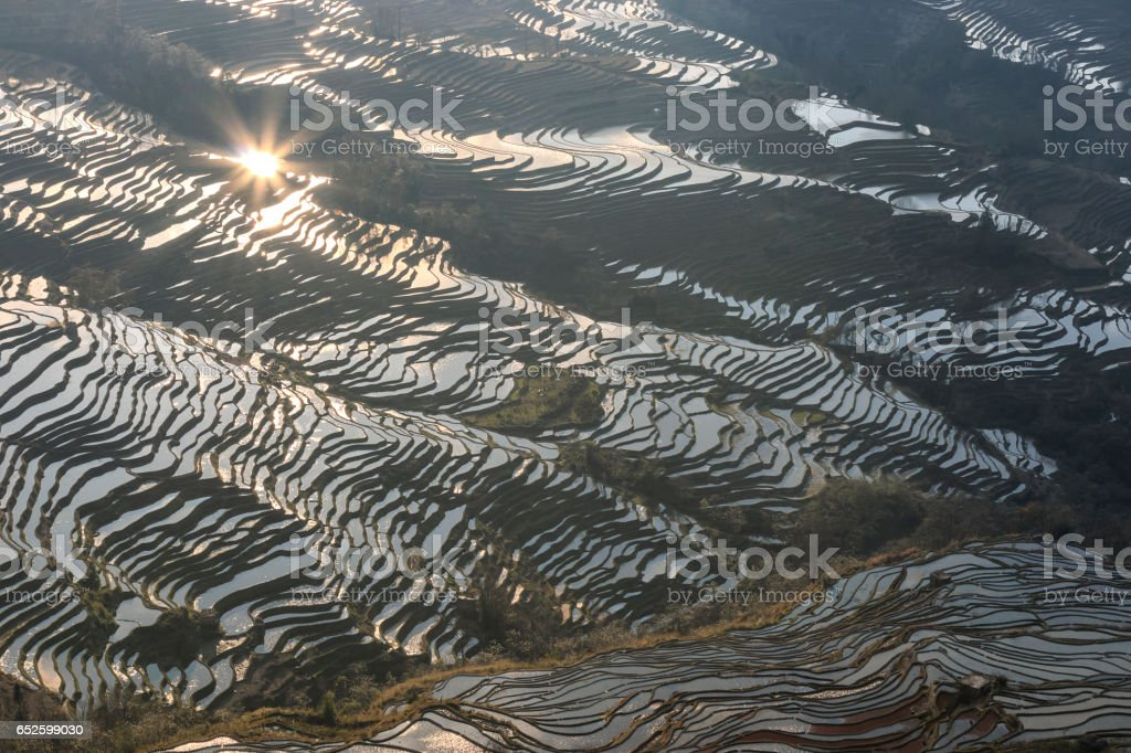 Sunset over YuanYang rice terraces in Yunnan, China, one of the latest UNESCO World Heritage Sites stock photo