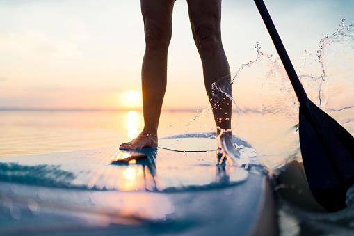 sunset paddleboarding on lake