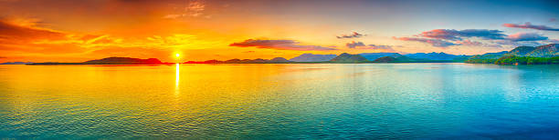 Sunset panorama Sunrise over the sea.  Panorama panoramic stock pictures, royalty-free photos & images