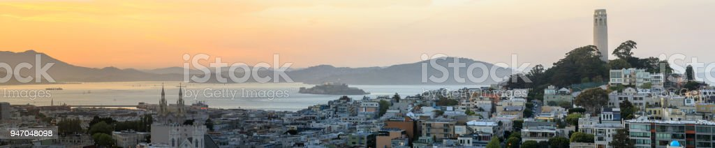 Sunset panoramic views of Telegraph Hill and North Beach neighborhoods with San Francisco Bay, Alcatraz and Angel Islands as well as Marin Headlands. stock photo