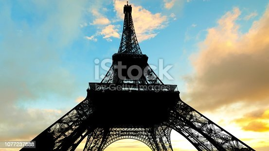Summer French sky with clouds, sun shining and clouds at sunset in Paris with Eiffel Tower in backlight.