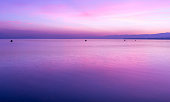 Beautiful colorful sunset sky with clouds over the lake Leman.  Lausanne Switzerlan. Ideal use for background