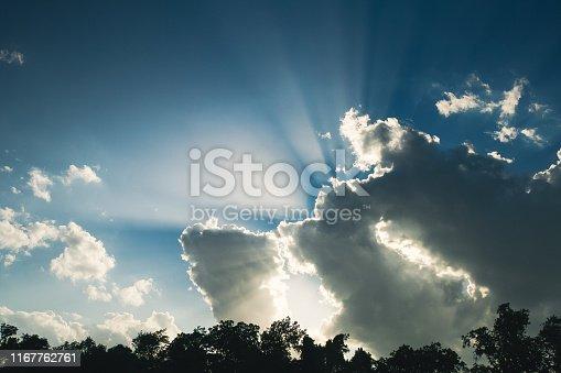 Wonderful shot of the sun shining through the clouds