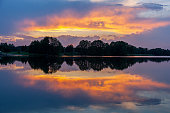 Sunset on the Kalwa lake in Poland. The reflection of the sky in the water.