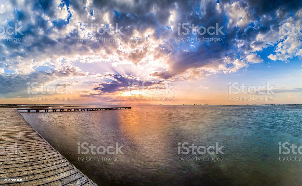 sunset pier delta ebro spain colored hdr cloud stock photo