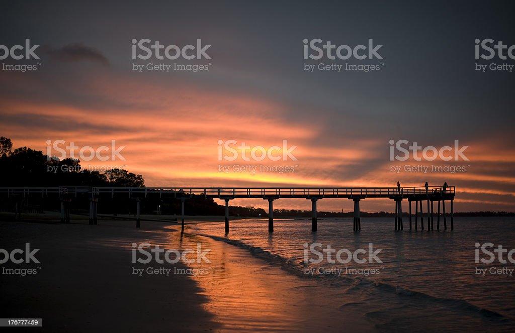Sunset pier silhouette - Hervey Bay, Queensland, Australia stock photo
