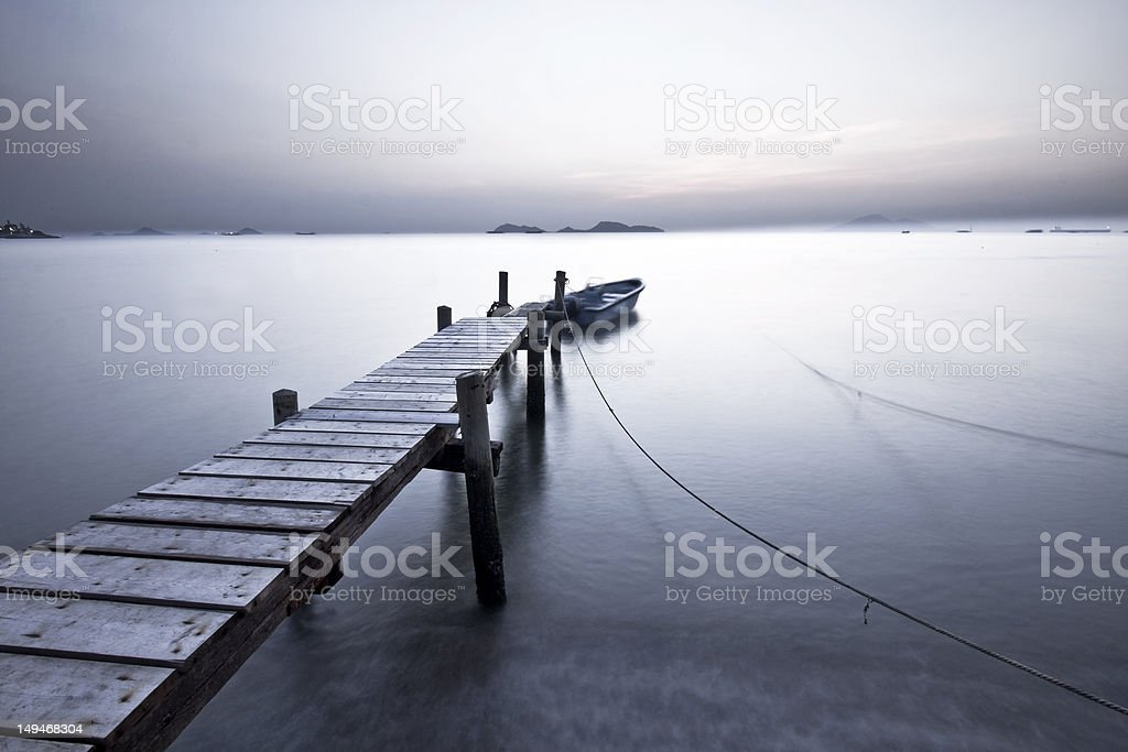 Sunset pier with low saturation style royalty-free stock photo