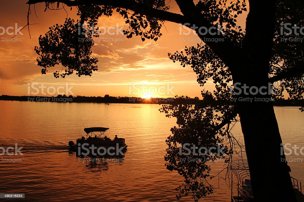 Sunset Pontoon Ride stock photo