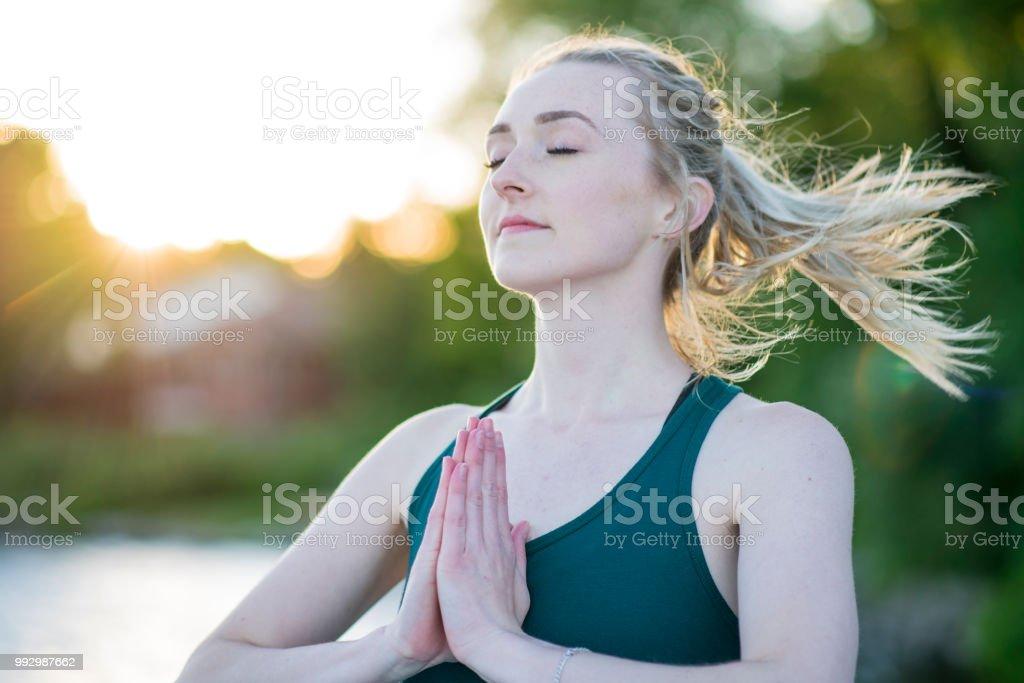 Sunset Prayer Pose stock photo